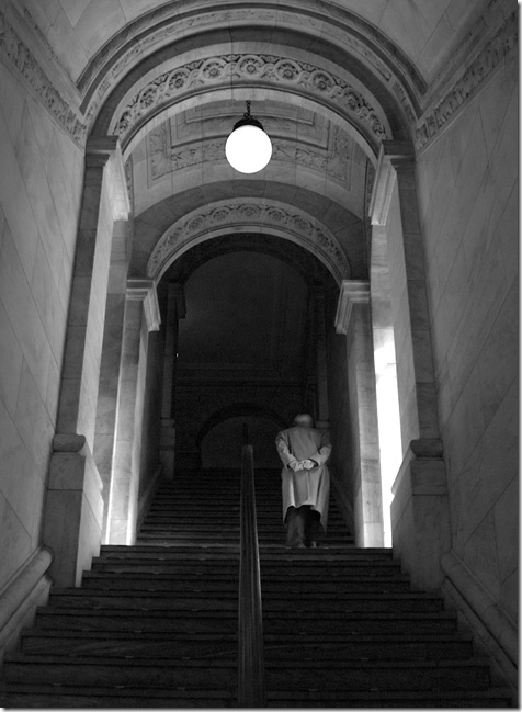 library man on stairs BW