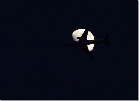 Plane Crossing the Moon