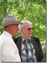 Hans Schmoldt and Scott Carpenter share a conversation at the Cattle Baron's Ball
